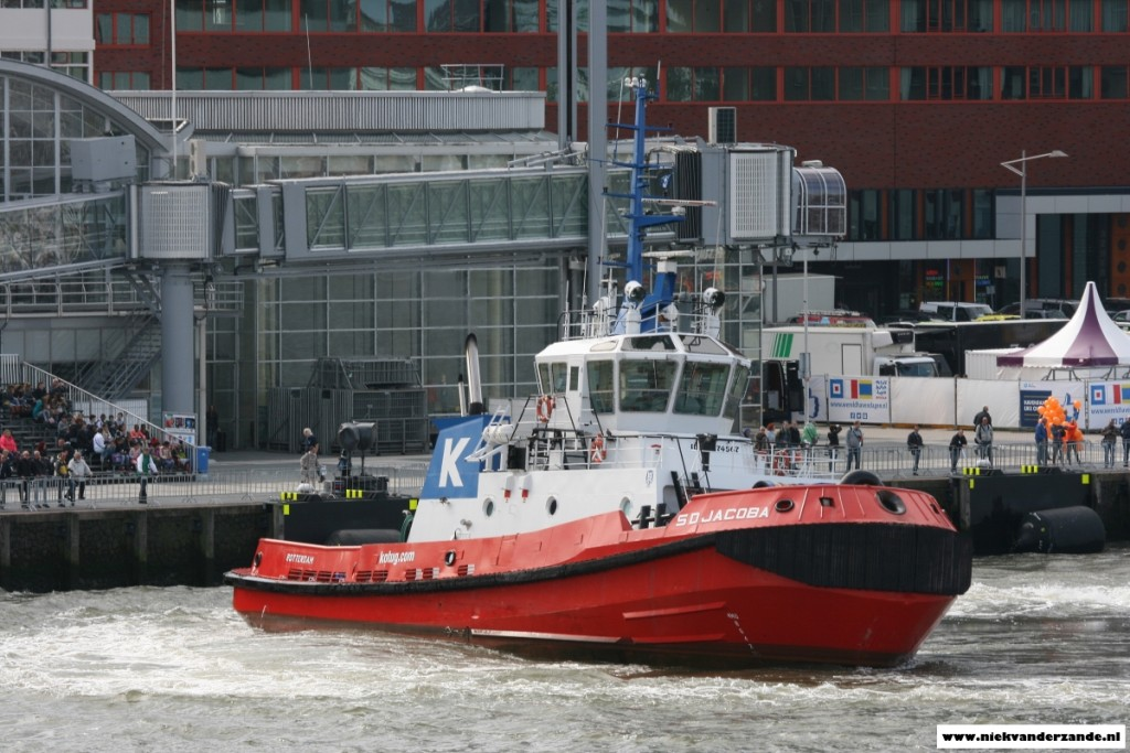 A tug shows its power and tight turning radius