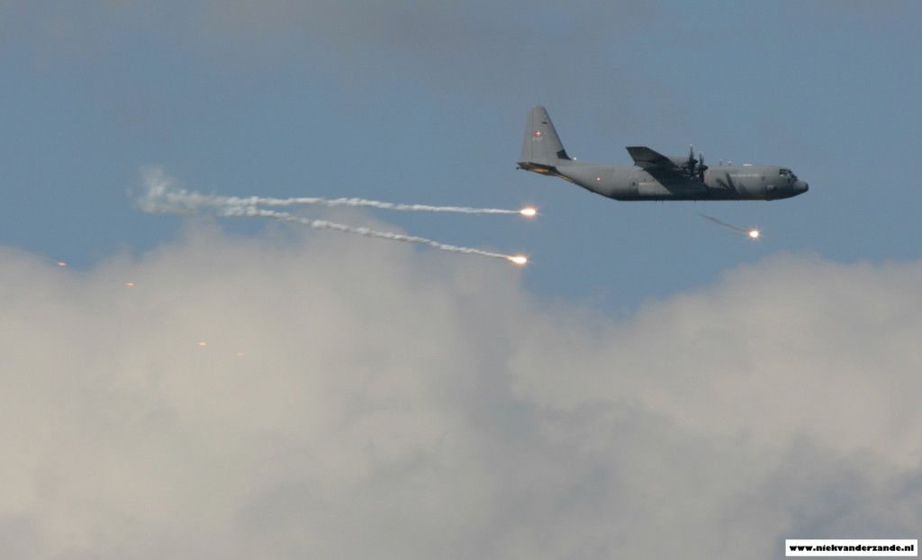 A Danish C-130J deploys flares over the Meppen Range