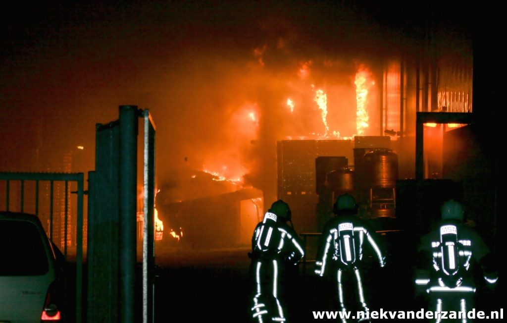 Firemen in action at a large fire in Hengelo