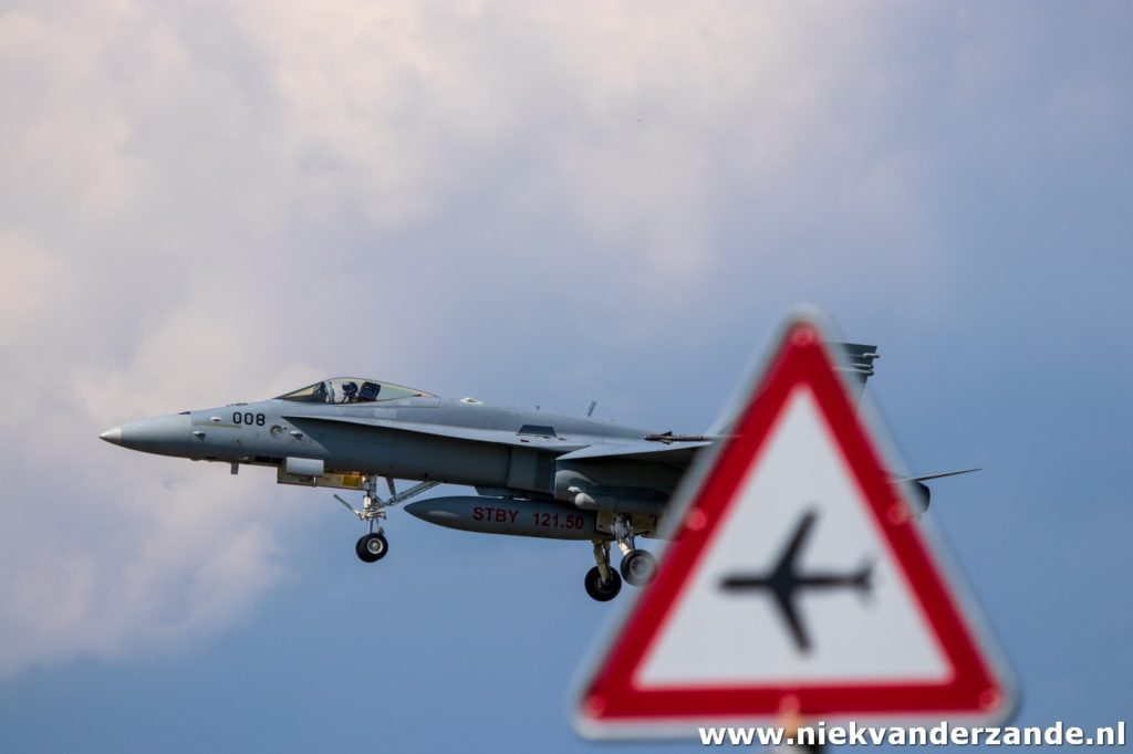 Hornet landing with traffic sign